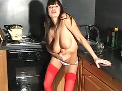 Red stockings on a big boobs brunette