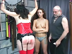 Latex corset girl bound in his dungeon