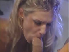 Lusty blond deep throats a huge cock and loves it