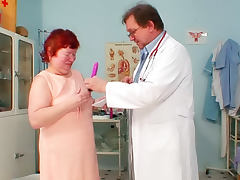 Mature redhead in gynecological exam tube porn video