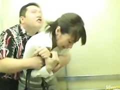 Japanese milf gets fucked hard in an elevator cage