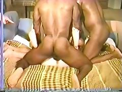 Weird chubby brunette gets fucked by pair of black studs on a couch tube porn video