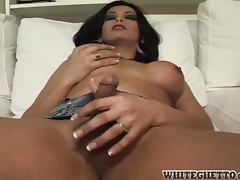 Transsexual gets naked and start whacking her cock