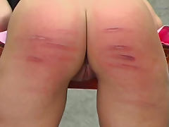 Her pain is real in a caning video porn tube video