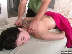 Sex hungry brunette girl fucks her masseur on a massage table