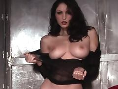 Carlotta Champagne poses for the cam in her fishnets porn tube video