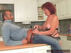 Mature bitch Marsha sucks and rides a big dick in the kitchen tube porn video