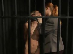 Ginger LEZDOM guard punishes petite sub in cage tube porn video