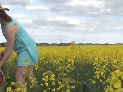 Natural lesbian girls on a canola field tube porn video