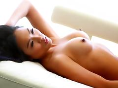 Asian hottie Kitty Lee boasts of her enhanced tits and nice ass