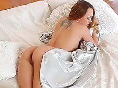 Blue Angel lying in her alluring bed and masturbating