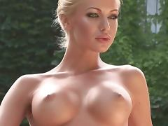 Eva Cifrov the hot blonde Slovakian girl poses naked in the courtyard
