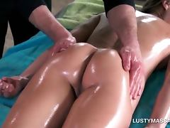 Hot babe gets naked body massaged with oil