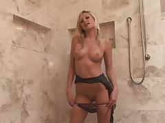 Adorable Nikki Ryann poses on the floor after taking a shower