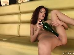 Naughty Leanna Sweet toys herself with bottle of champagne