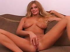 Big titty blonde fingers her pretty pussy