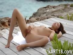 chinese angel teasing by the ocean