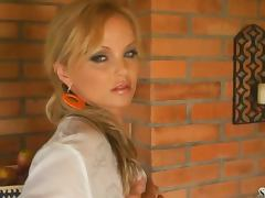 Hot afternoon striptease by a fiery blond Silvia Saint