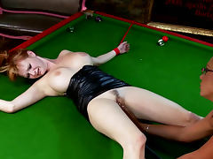 Emma Butt and Tarra White is playing billiard