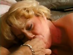 Round ass MILF gobbles young stud on sofa tube porn video