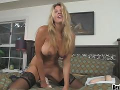 Jezebel Jones fingers her pussy and slams it with a huge dildo