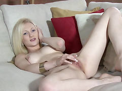 Sporty blonde Chloe Devine fingers her pussy