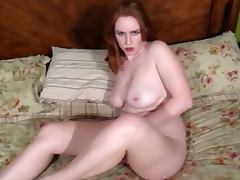 Busty redhead babe talks dirty while fucking tube porn video