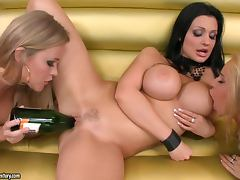 Three hot lesbians slam each other's pussies with a bottle porn tube video