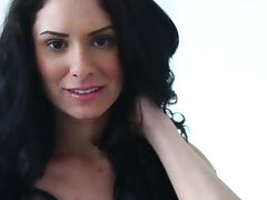 Cute brunette Raquel Robin undresses and strokes her gorgeous body