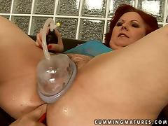 Lewd granny Caitlin moans loudly while getting her pussy toyed