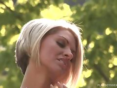 Brandi Corbin pours her boobs with water in the backyard