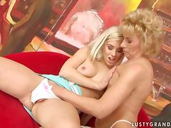 Margarette plays lesbian games with a hot blonde in the club