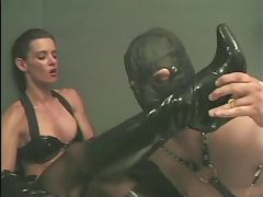 Guy in mask sucking on his Mistress' boots