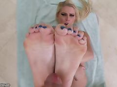 Vanessa Cage gives a footjob and enjoys some naughty banging