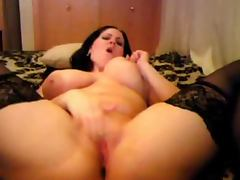Big Boobed Hottie dildoes herself to a oozing mess