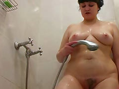 Chubby brunette Ksenya washes her body