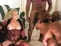 Two slutty milfs get fucked by two horny black studs