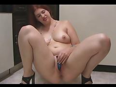 chubby girl strips in kitchen