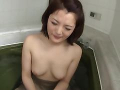 Japanese chick sucks her BF's prick in the bathroom