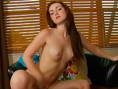 Sweet brunette Natalie Lust is poking her shaved hole