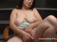 Busty Mature Woman Masturbating Using Vibrator While Sitting On The Chair tube porn video