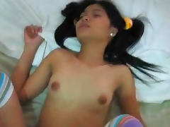 Nasty pigtailed Thai babe being drilled so hard in her pussy tube porn video