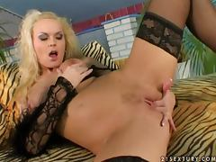 Gina B shows off her nice pussy and slams it with a glass dildo