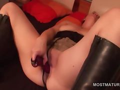 Nasty mature in boots fucks herself with a vibrator