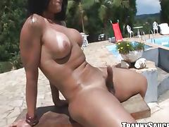 Sexy brunette tranny tugging her hard cock