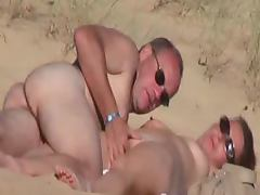 Brown haired hottie gets her pussy fingered on a beach