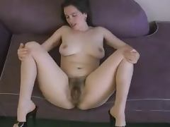 Kinky dark haired girl shows off her ugly hairy snatch tube porn video