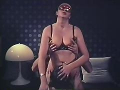 Sexy masked group in the dark