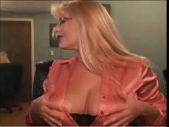 Busty blonde wearing glasses is playing around on her webcam