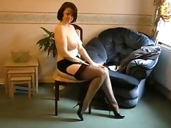Horny milf puts on her nylon stockings and starts teasing